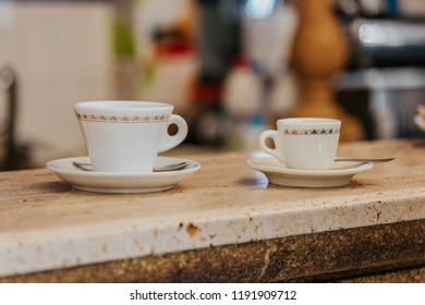 Two white coffee cups on a coffee bar counter, Italian breakfast with americano and espresso coffee