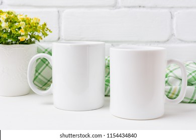 Two white coffee  mug mockup with small yellow and green flowers.  Empty mug mock up for design promotion.