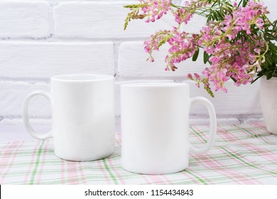 Two white coffee  mug mockup with small pink flowers.  Empty mug mock up for design promotion.
