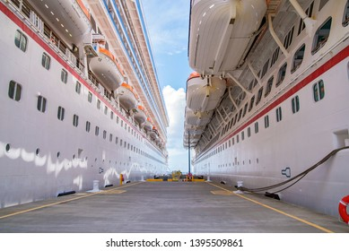 Two white Cruise ships docked next to each other in the port of Grand Turk, Bahamas.