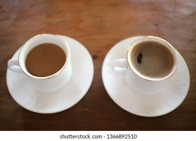 two a white cup of coffee, top view isolated on wood table background