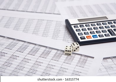 two white dice on the financial sheet with calculator