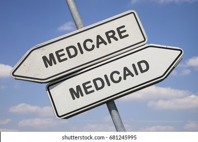 two white direction signs with arrows and the words medicare and medicaid, political and social concept for us health care
