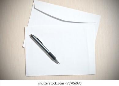 Two white envelopes with pen