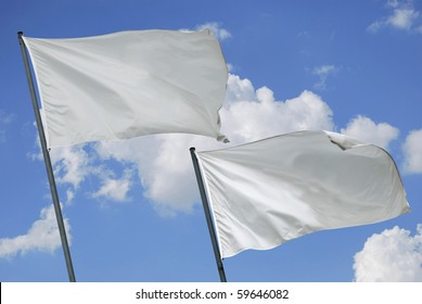 Two white flags waving on the wind