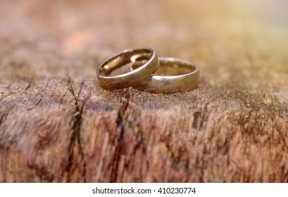 two white gold wedding rings on wood background