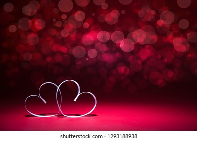 Two white Hearts on red background. Valentines day card. Copy space for your text.