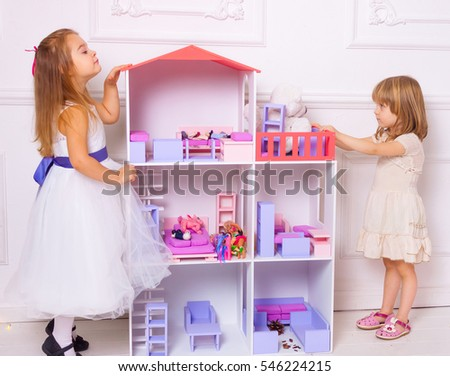 House Toys For Girls : Two white little girls play toys stock photo edit now