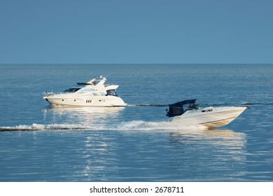 Two white motor boats at sea