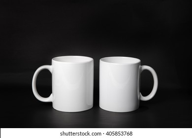 Two white mugs for coffee, tea or water on dark background, mockup front view.