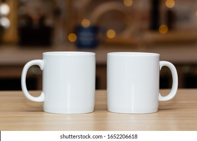 Two white mugs for mock-up on a kitchen table