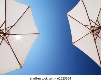 two white parasol directly above