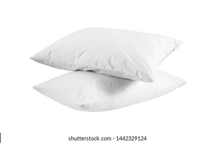 Two white pillows isolated, pillows on a white background, two pillows piled against white background. Side view.