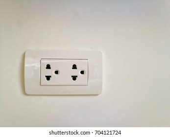 two white plug and white background.