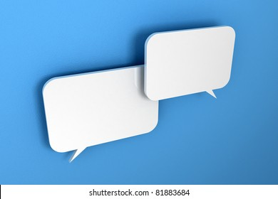Two white speech bubbles over light blue, textured wall