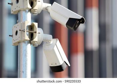 two white surveillance security cctv cameras