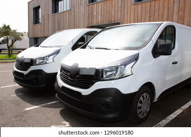 two white van front of warehouse reday for delivery parcel