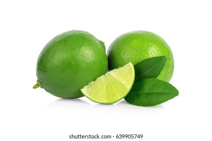 Two whole lime fruits and a piece with leaves isolated on white background