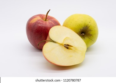 two whole and one halved apple