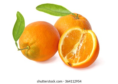 Two whole oranges with with leaves and half isolated on white background