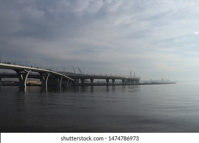 two winding highway bridges over the wide river with the fog futuristic view