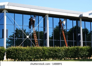 Two window cleaners at work