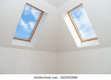 Two windows in the attic ceiling