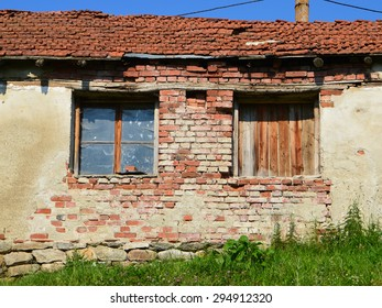 Two windows of a ruined rural cottage