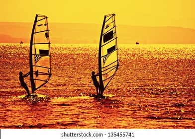 Two windsurfers In Red Sea, toned photo