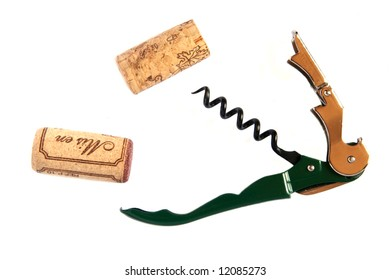 Two wine corks and a corkscrew isolated on white background