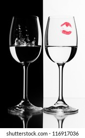 two wine glasses in back light on the black and white contrast background