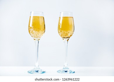 two wine glasses with a garland on a table