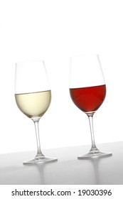 Two wine glasses one red one white in the studio