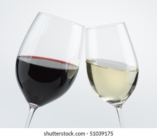 Two wine glasses red and white toasting