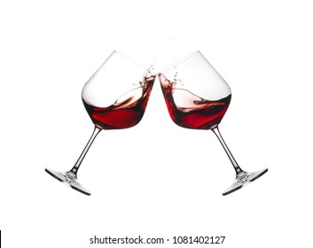 Two wine glasses in toast with splashing isolated on a white background.