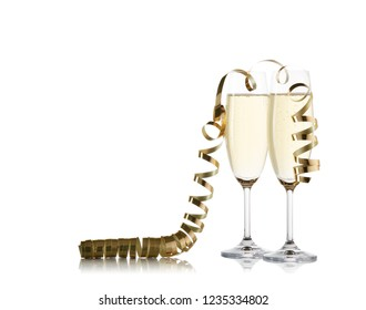 Two wineglasses with champagne and  serpentine isolated on a white background with reflection. Copy space