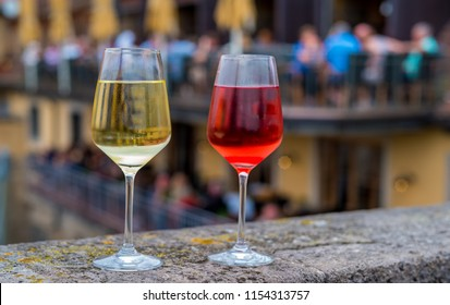 Two wineglasses on the fence of  old  Bridge across the Main river in Wurzburg, Germany.