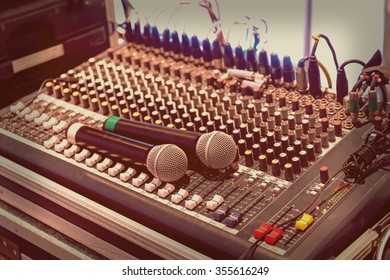 Two wireless microphone on sound mixer control panel