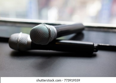 two wireless microphone on the window