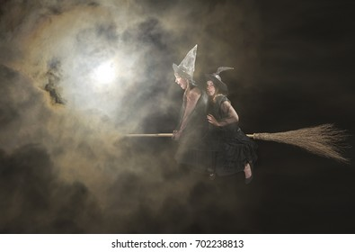 two  witches flying on a broom