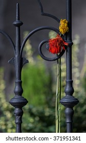 two withered gerbera on a railing in the cemetery