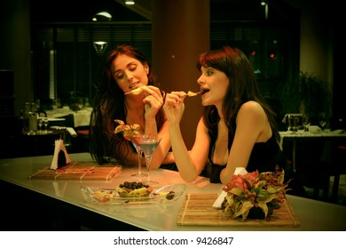 two woman in a cocktail bar