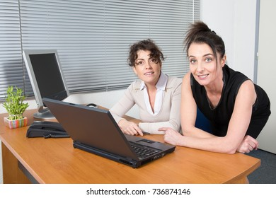Two woman at desk for financial business meeting