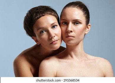 two woman with a different type of healthy skin on a blue