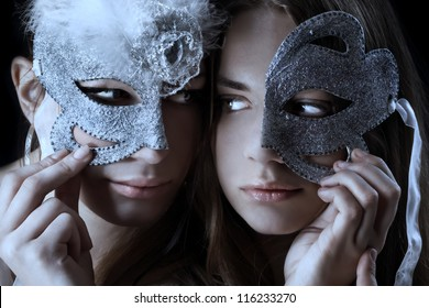 Two woman with half broken mask/Mask ball