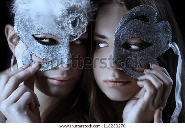 Two woman with half broken mask/Mask ball