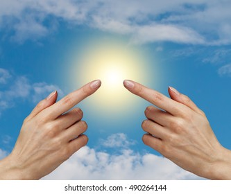 two woman hand on blue sky background,touch sunlight