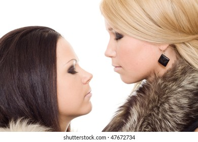 two woman isolated fur black blond close eye makeup
