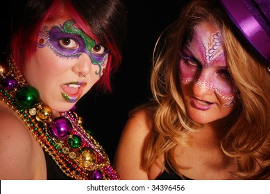 Two woman partying it up for Mardi Gras
