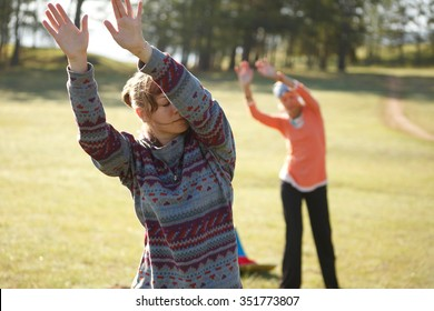 Two woman are practicing Qi Gong
